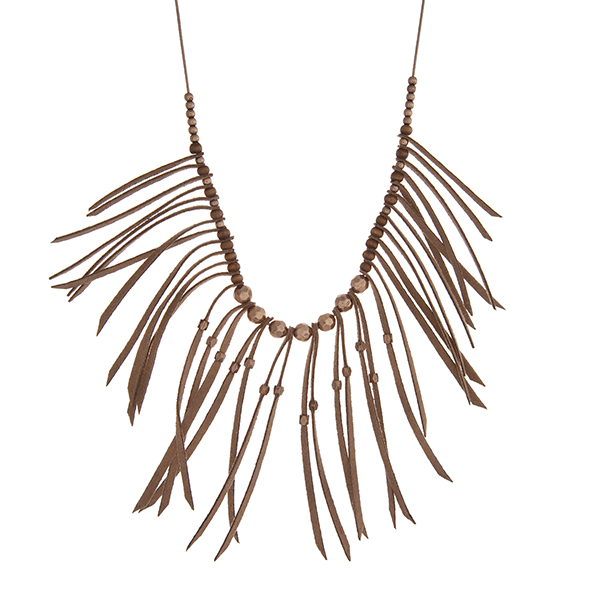 """Adjustable brown cord necklace with brown fringe and gold tone bead accents. Approximately 36"""" in length."""