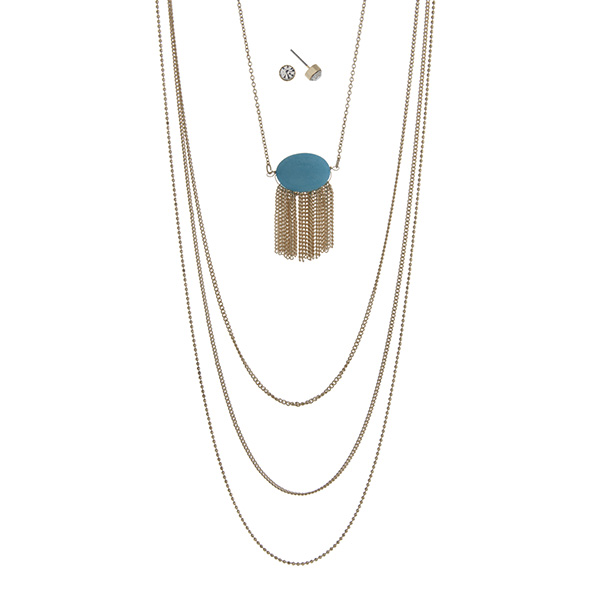 "Gold tone multi-layer necklace featuring a turquoise stone with metal fringe. Approximately 32"" in length."