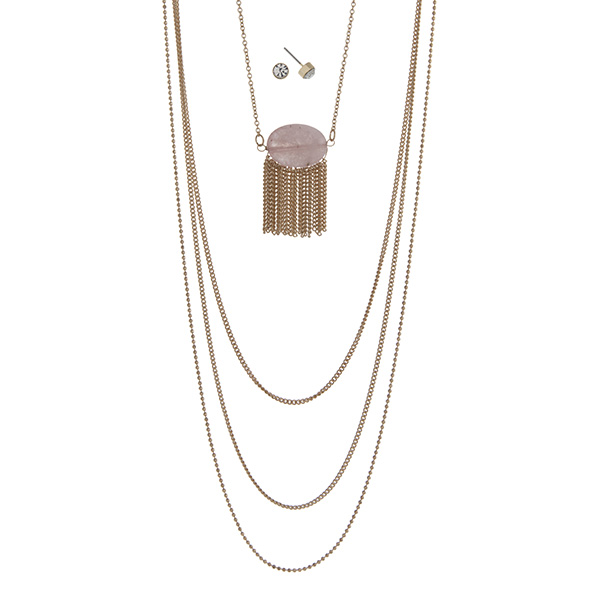 """Gold tone multi-layer necklace featuring a rose quartz stone with metal fringe. Approximately 32"""" in length."""