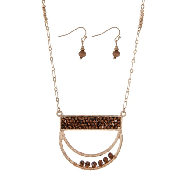 """Gold tone necklace set featuring a half circle pendant accented with bronze beads. Approximately 32"""" in length."""