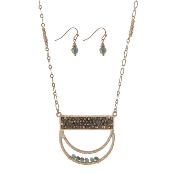 "Gold tone necklace set featuring a half circle pendant accented with turquoise beads. Approximately 32"" in length."