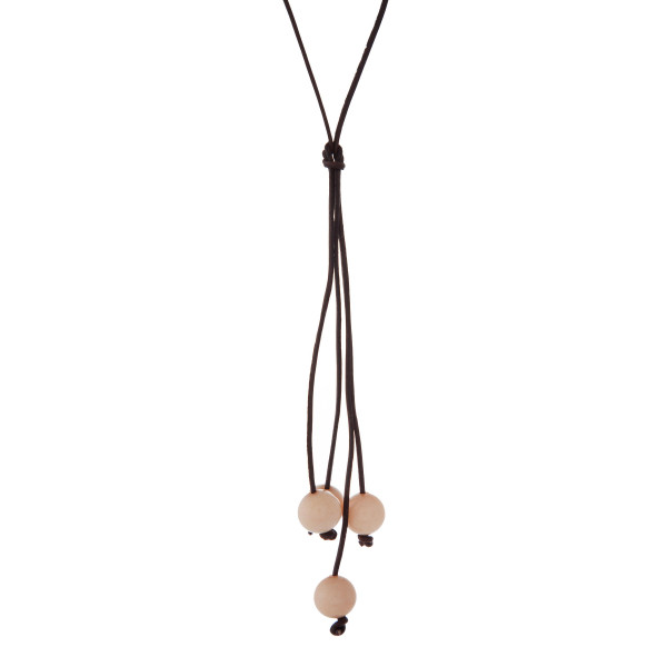 """Brown cord necklace with a peach natural stone beaded tassel. Approximately 32"""" in length."""