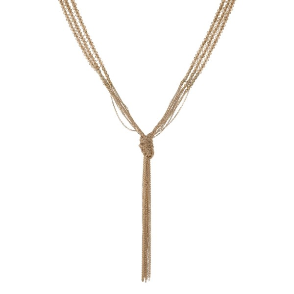 """Gold tone multi layer necklace with topaz beads and a knotted tassel. Approximately 32"""" in length."""
