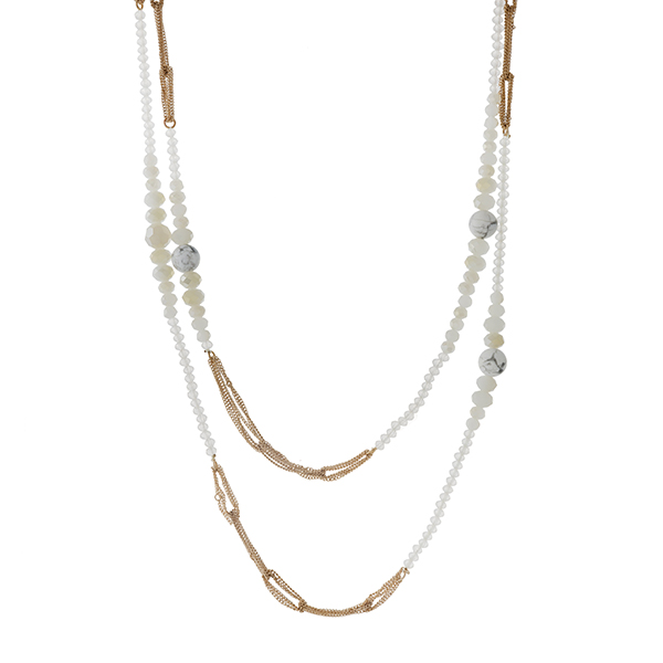 """Gold tone double layer necklace with howlite and white opal beads. Approximately 30"""" in length."""