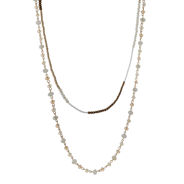 "Gold tone double layer necklace with wooden and ivory beads. Approximately 32"" in length."