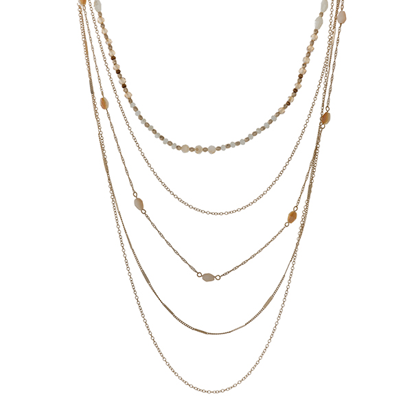 "Gold tone multi layer necklace with ivory and champagne beads. Approximately 32"" in length."