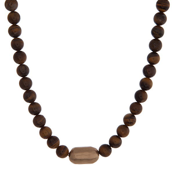 """Tiger's eye beaded necklace with a hammered gold tone nugget. Approximately 16"""" in length."""