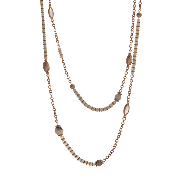 "Gold tone wrap necklace with ivory beads. Approximately 60"" in length."