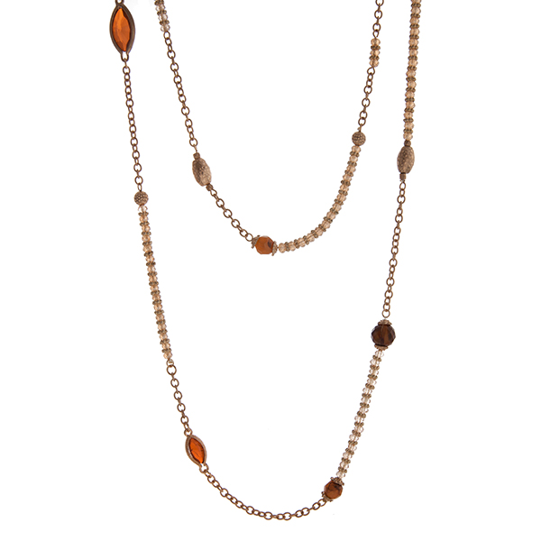 """Gold tone wrap necklace with topaz and brown beads. Approximately 60"""" in length."""