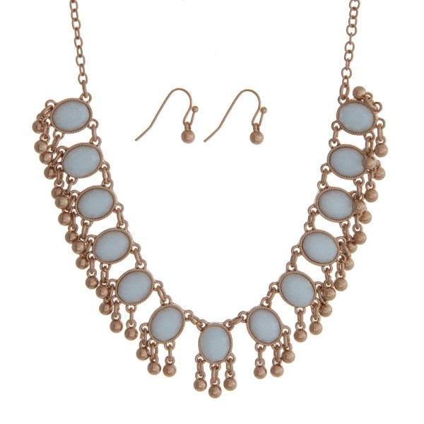 """Gold tone necklace set with light blue oval stones and matching fishhook earrings. Approximately 18"""" in length."""