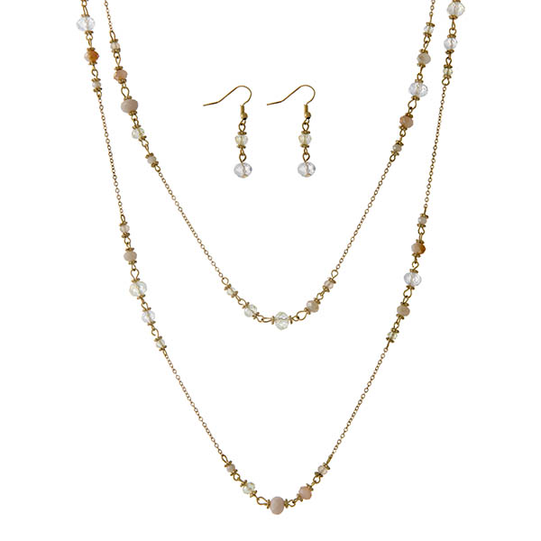 "Gold tone wrap necklace set with ivory and champagne stones. Approximately 60"" in length."