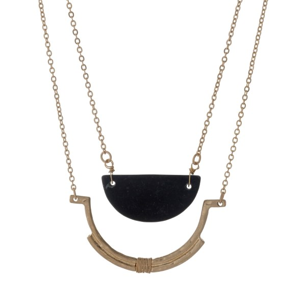 """Gold tone necklace with a half circle black stone pendant. Approximately 32"""" in length."""