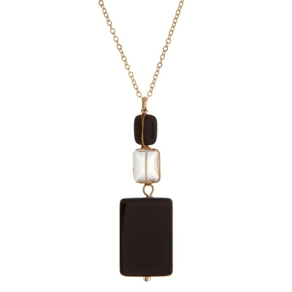 """Gold tone necklace with black and clear wire wrapped square stones. Approximately 24"""" in length."""