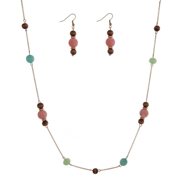 """Gold tone necklace set with wooden beads accented with pink and turquoise stationary beads. Approximately 44"""" in length."""