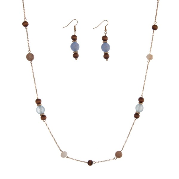 "Gold tone necklace set with wooden beads accented with gray and ivory stationary beads. Approximately 44"" in length."