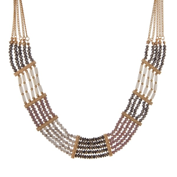 """Gold tone statement necklace with purple, gray, ivory and Dalmatian beads. Approximately 18"""" in length."""
