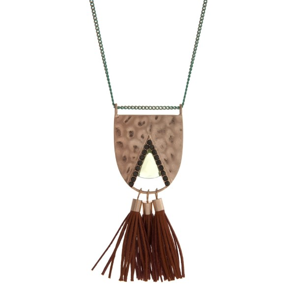 """Gold tone and mint green beaded necklace with a hammered pendant and tan tassels. Approximately 32"""" in length."""