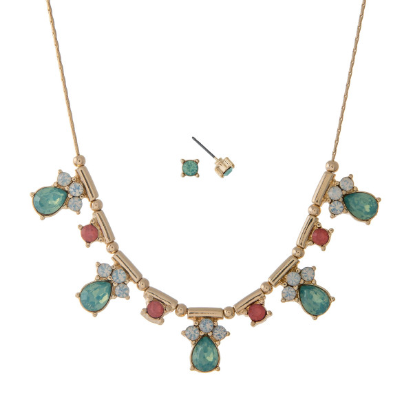 """Dainty gold tone necklace set with mint green rhinestones. Approximately 16"""" in length."""