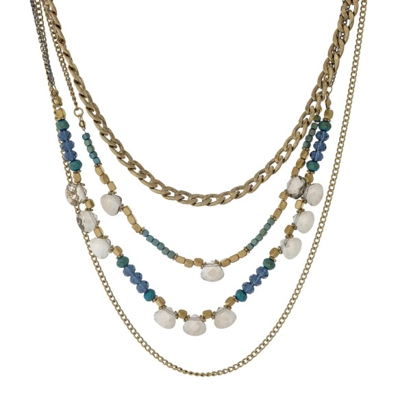 """Gold tone multi layer necklace with navy blue and iridescent beads. Approximately 24"""" in length."""