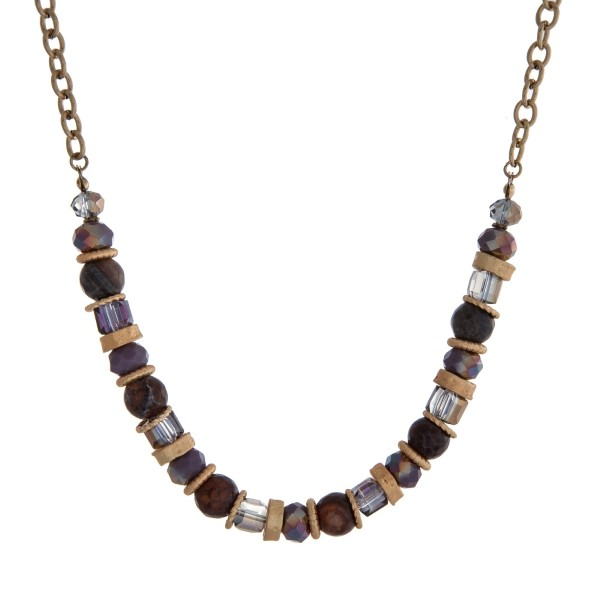 """Gold tone necklace with purple and brown beads. Approximately 18"""" in length."""
