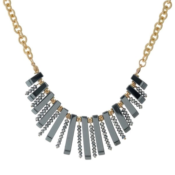 """Gold tone necklace with hematite beads and fringe. Approximately 16"""" in length."""