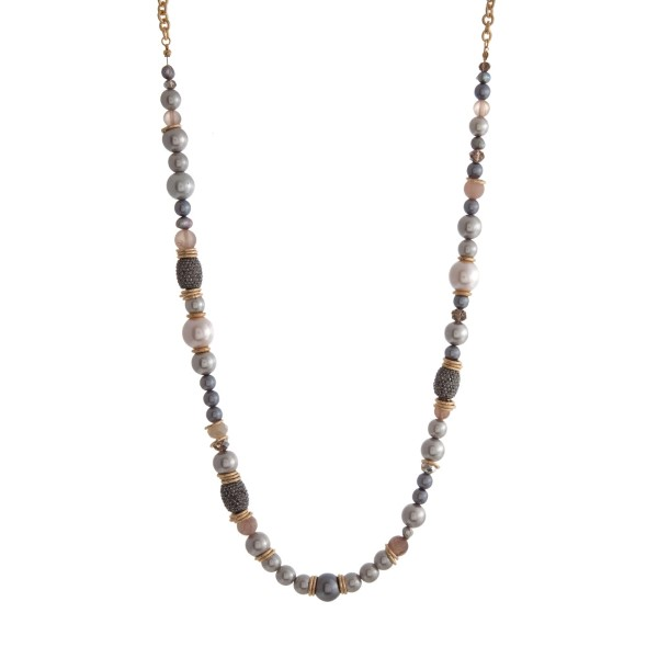 "Gold tone necklace with assorted gray pearl beads. Approximately 32"" in length."