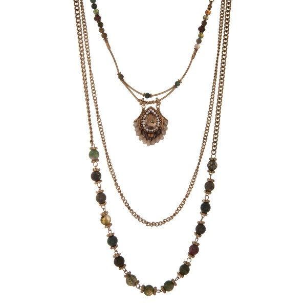"""Gold tone triple layer necklace with hunter green and olive glass beads and a champagne teardrop rhinestone. Approximately 16"""" in length."""