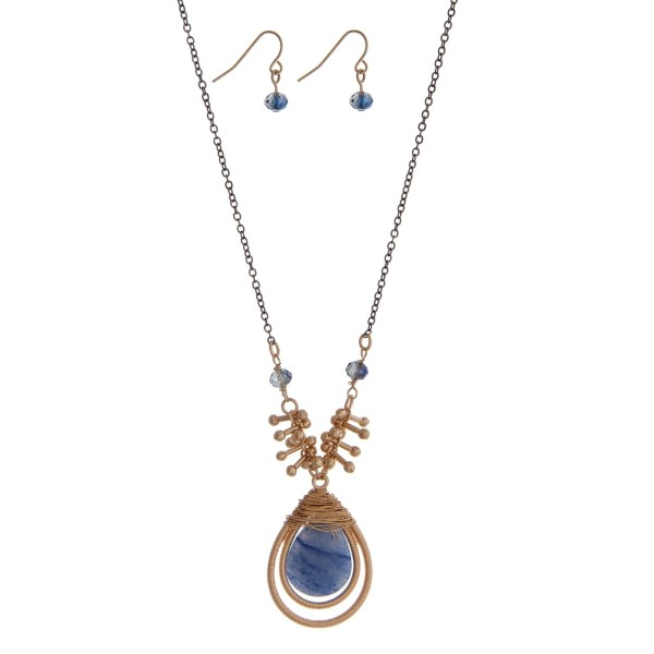 """Two tone necklace set featuring a wire wrapped navy blue teardrop pendant and matching earrings. Approximately 28"""" in length."""