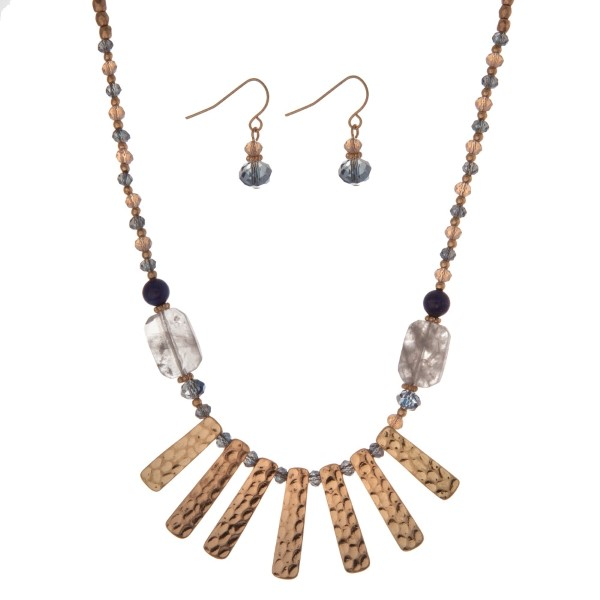 "Gold tone necklace set with gray and blue beads and metal fringe. Approximately 18"" in length."