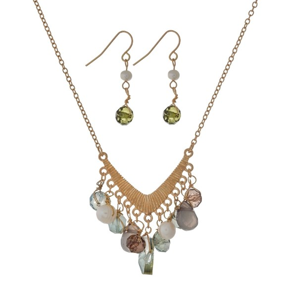 """Gold tone necklace set with a 'v' shaped pendant and green bead charms. Approximately 18"""" in length."""