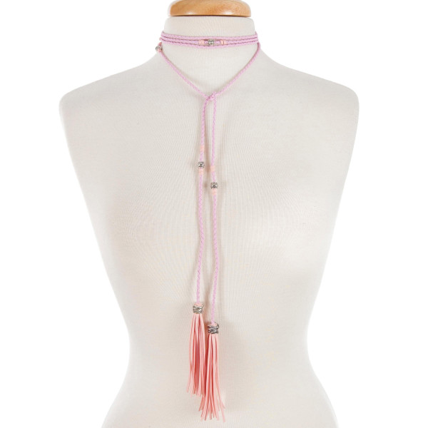 """Light pink braided open wrap necklace with silver tone beads and tassels. Approximately 80"""" in length."""