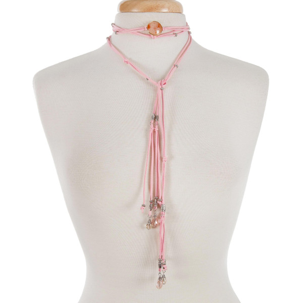 """Pink cord open wrap necklace with a peach stone and silver tone beads. Approximately 80"""" in length."""