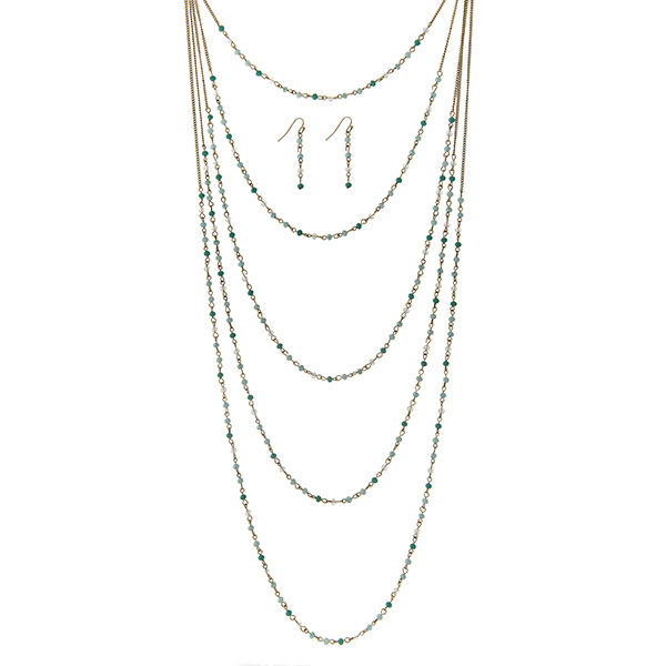 "Gold tone multi layer necklace set with turquoise and white opal beads. Approximately 32"" in length."