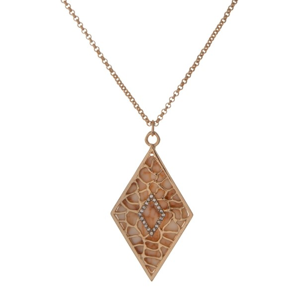 "Gold tone necklace with an ivory diamond shape pendant. Approximately 18"" in length."
