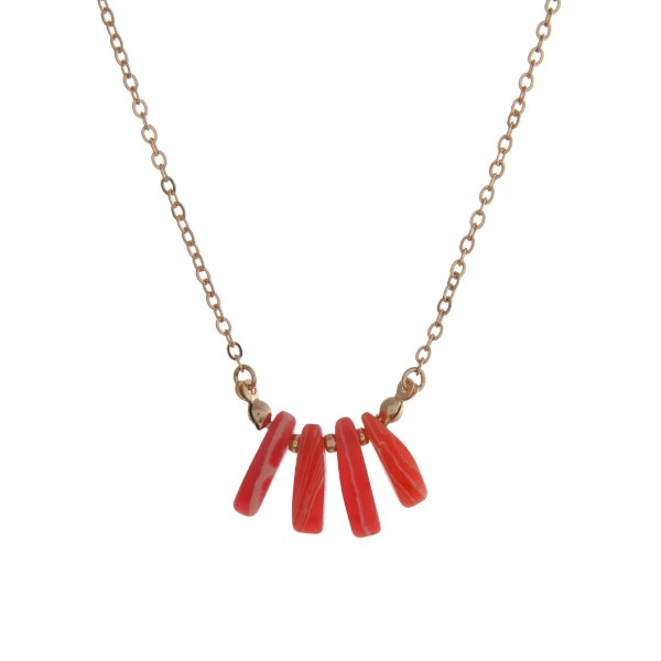 "Dainty gold tone necklace with coral natural stones. Approximately 16"" in length."