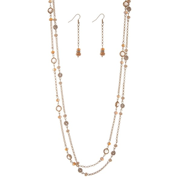 "Gold tone double layer necklace set with champagne and ivory beads. Approximately 30"" in length."