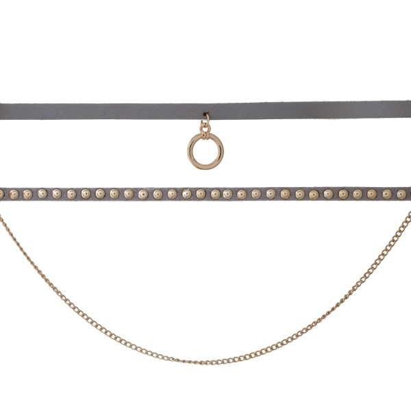 """Gold tone triple layer choker set with gray faux leather, studs and a circle pendant. Approximately 14"""" in length."""