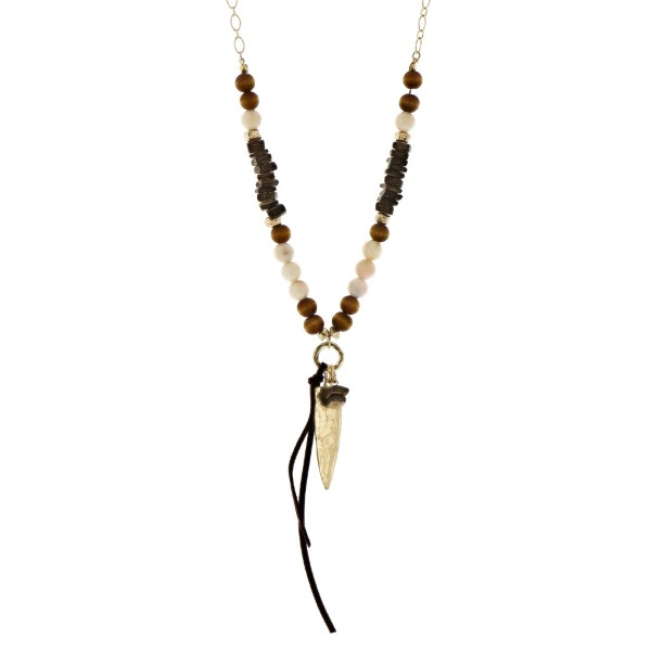 "Gold tone necklace with wooden and ivory beads and an arrowhead pendant. Approximately 32"" in length."