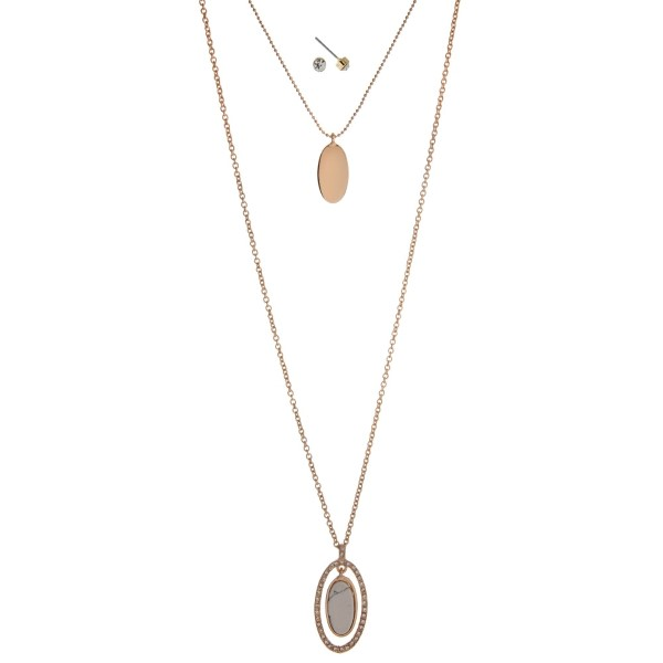 """Gold tone double layer necklace set with a howlite stone pendant. Approximately 32"""" in length."""