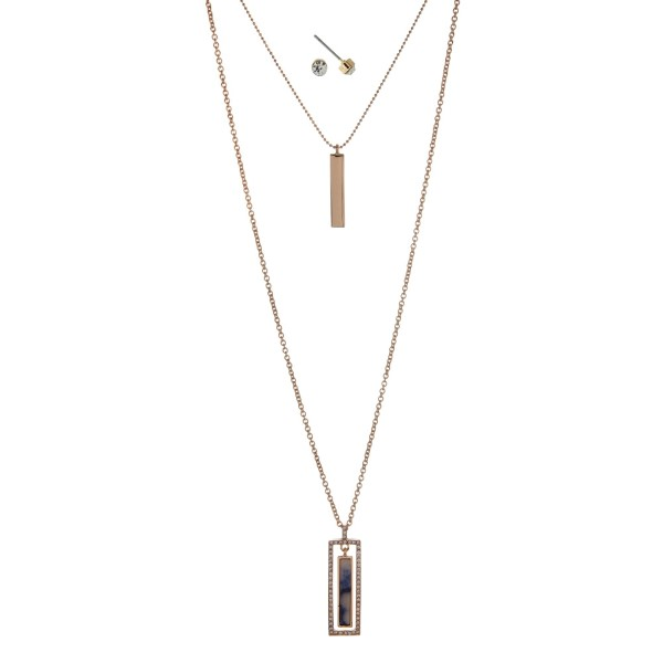 "Gold tone double layer necklace set with a blue lapis rectangle stone pendant. Approximately 32"" in length."