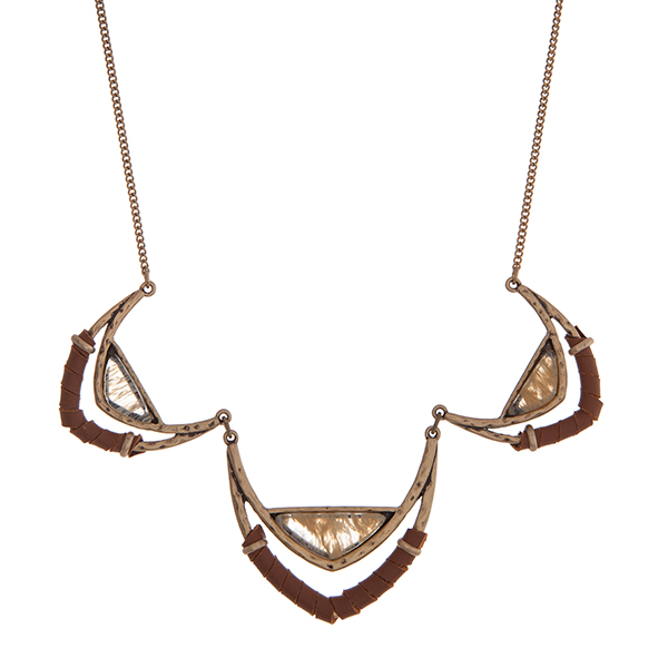 """Gold tone necklace with leather cord and beige stones. Approximately 16"""" in length."""