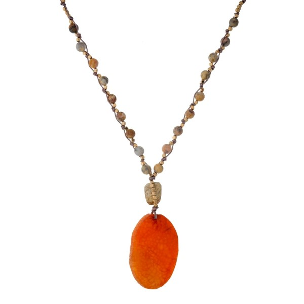 """Bronze cord necklace with knotted natural stone beads and a orange stone pendant. Approximately 32"""" in length. Handmade in the USA."""