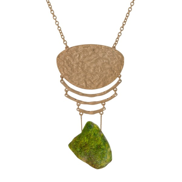 """Gold tone necklace with a hammered pendant and a green natural stone. Approximately 32"""" in length."""