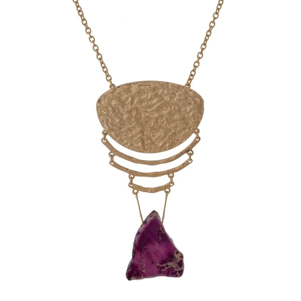 """Gold tone necklace with a hammered pendant and a purple natural stone. Approximately 32"""" in length."""