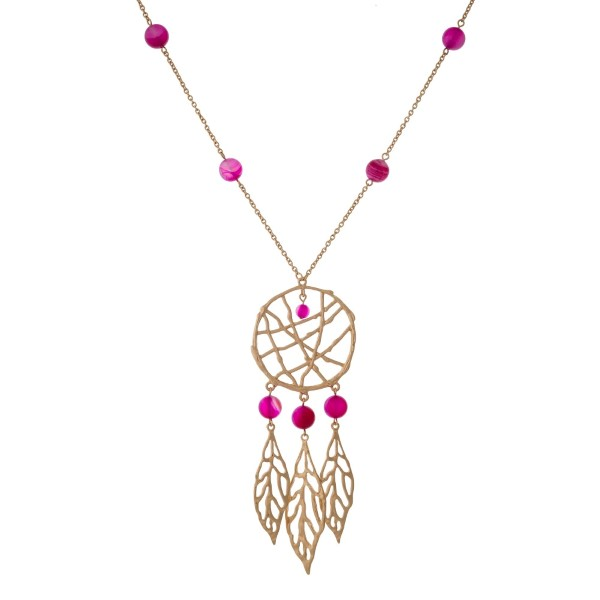 """Gold tone necklace with fuchsia beads and a dream catcher pendant. Approximately 32"""" in length."""