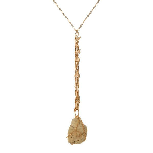 "Gold tone 'Y' necklace with fringe and a wire wrapped ivory nugget stone. Approximately 32"" in length."