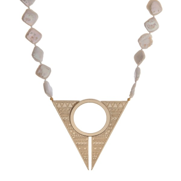 "Gold tone necklace with freshwater pearls and a stamped geometric pendant. Approximately 16"" in length. Handmade in the USA."
