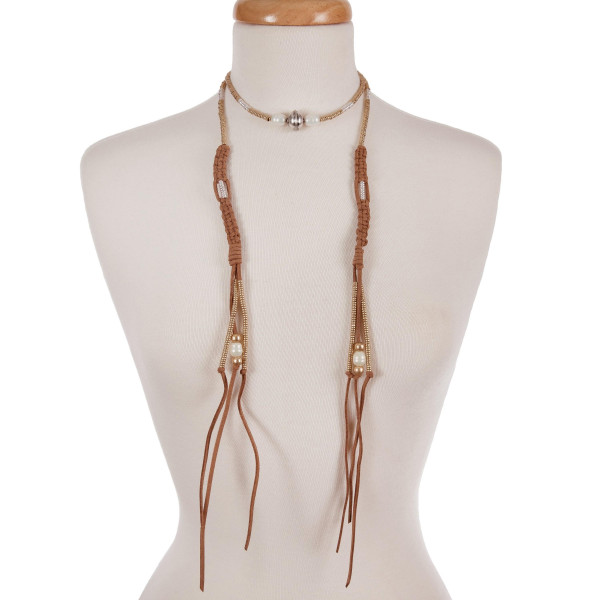 """Tan suede wrap necklace with gold, silver, and pearl tone beads. Approximately 54"""" in length."""