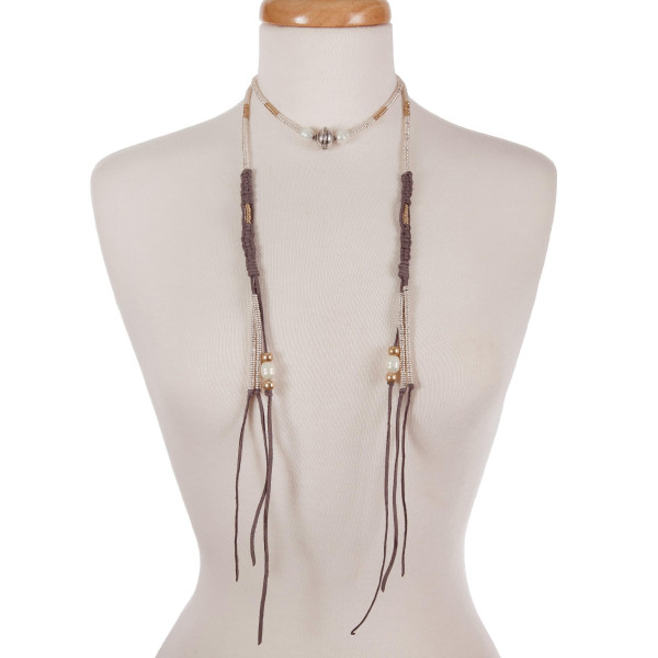"""Gray suede wrap necklace with gold, silver, and pearl tone beads. Approximately 54"""" in length."""