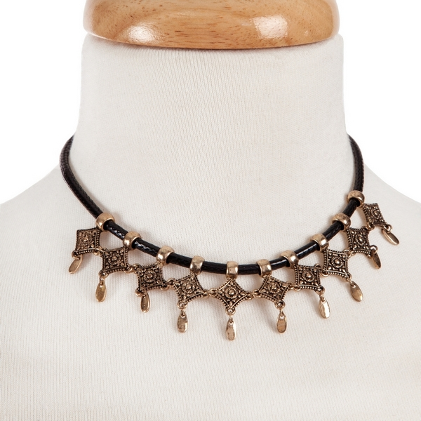 """Black braided choker with gold tone charms. Approximately 12"""" in length."""
